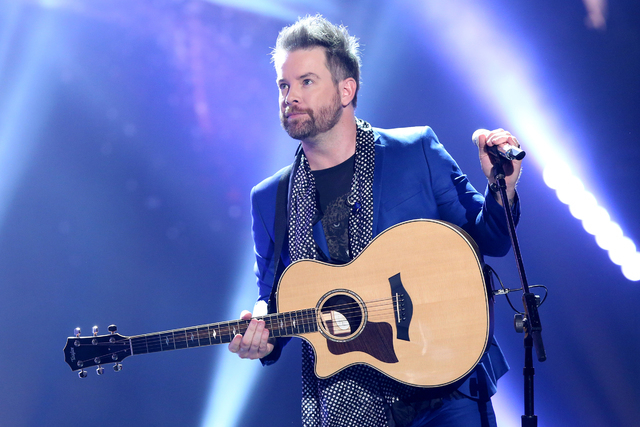 """David Cook performs at the """"American Idol"""" farewell season finale at the Dolby Theatre on Thursday, April 7, 2016, in Los Angeles. (Photo by Matt Sayles/Invision/AP)"""