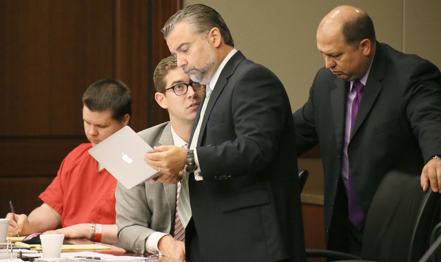 The defense team of Justin Ross Harris -- Carlos Rodriguez, center left, Maddox Kilgore and T. Bryan Lumpkin -- discuss information in Cobb County Superior Court Judge Mary Staley's courtroom on T ...