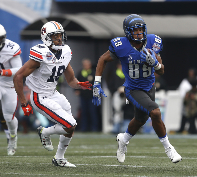 Memphis wide receiver Phil Mayhue (89) carries the ball after a reception over Auburn defensive back Carlton Davis (18) during the first half of the Birmingham Bowl NCAA college football game, Wed ...