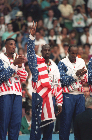 The USA's Scottie Pippen, left, with Michael Jordan, center, and Clyde Drexler, pose with their gold medals after beating Croatia 117-85 in Olympic basketball at Barcelona, Aug. 8, 1992.  (Susan R ...