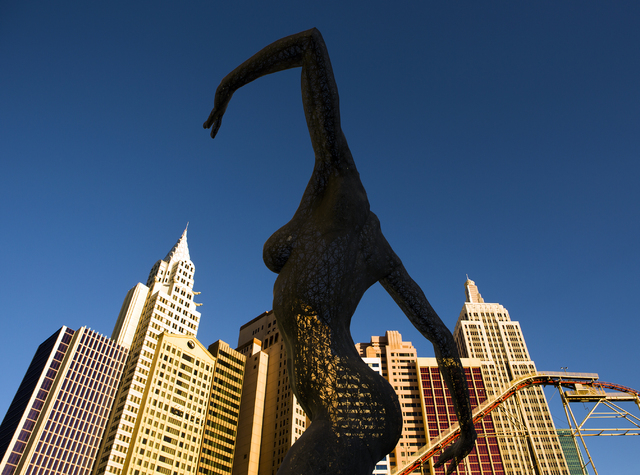Bliss Dance sculpture created by artist Marco Cochrane is seen with New York-New York in the background on  Wednesday, March 23, 2016. Jeff Scheid/Las Vegas Review-Journal Follow @jlscheid