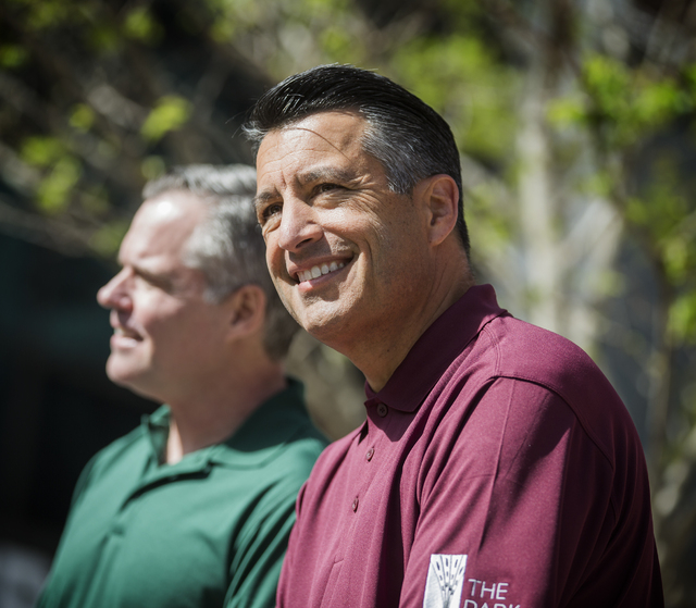 Jim Murren,left,  chairman and CEO of MGM Resorts International, and Nevada Gov. Brian Sandoval sit during a grand opening party at The Park on Monday, April 4, 2016. ( Jeff Scheid/Las Vegas Revie ...