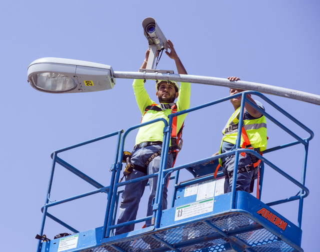 Edgar Vasquez, adjusts a traffic camera on the first traffic light in Baker, Cal. on Monday, May, 23, 2016. The owner of Baker Travel Plaza spent four years trying to install the signal because it ...