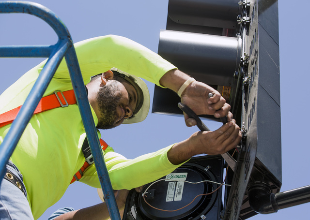 Edgar Vasquez, adjusts a traffic camera on the first traffic light in Baker, Cal. on Monday, May, 23, 2016.The owner of Baker Travel Plaza spent four years trying to install the signal because it  ...