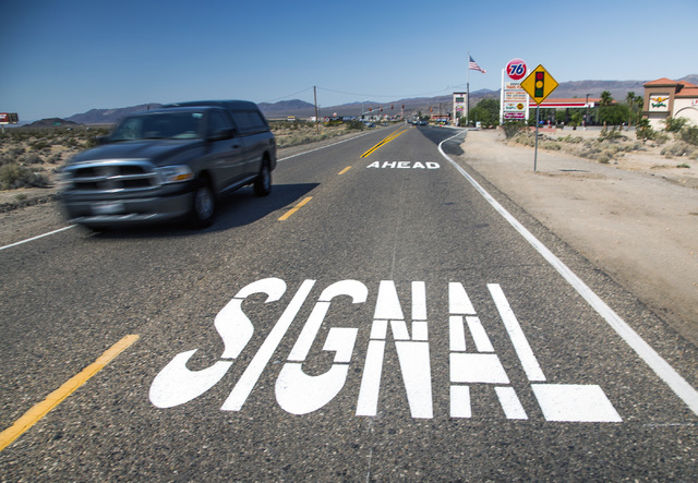 A sign painted on Baker Boulevard inform drivers of the first traffic light in Baker, Cal. on Monday, May, 23, 2016. The owner of Baker Travel Plaza spent four years trying to install the signal b ...