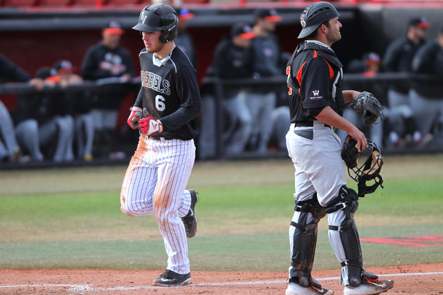 Payton Squier, left, shown last season, was one of six UNLV players with multiple hits Sunday in the Rebels' 10-4 victory over New Mexico at Wilson Stadium. (Erik Verduzco/Las Vegas Review-Journal)