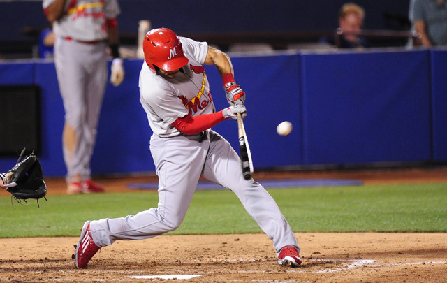 Memphis Redbirds batter Tommy Pham, a Durango High School graduate, hits a single in the sixth inning of their minor league baseball game against the Las Vegas 51s at Cashman Field in Las Vegas Fr ...