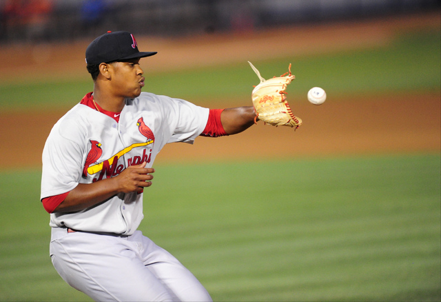 Memphis Redbirds starting pitcher Alex Reyes fields a throw to first base on a Las Vegas 51s ground ball  in the fourth inning of their minor league baseball game at Cashman Field in Las Vegas Fri ...