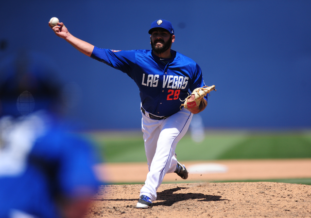 Las Vegas 51s relief pitcher Chasen Bradford delivers to the Memphis Redbirds runner in the sixth inning of their Triple-A minor league baseball game at Cashman Field in Las Vegas Monday, May 30,  ...