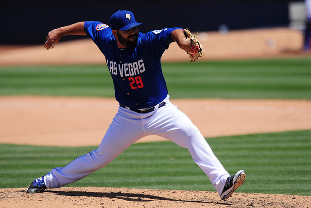 Las Vegas 51s relief pitcher Chasen Bradford delivers to the Memphis Redbirds runner in the seventh inning of their Triple-A minor league baseball game at Cashman Field in Las Vegas Monday, May 30 ...