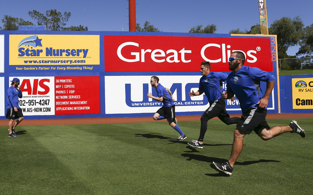 Las Vegas 51s players, from left, Jeff Walters, Erik Goeddel, Paul Seward, Chasen Bradford and Jeff Walters warm up ahead of a game against the El Paso Chihuahuas in Las Vegas on Friday, May 13, 2 ...