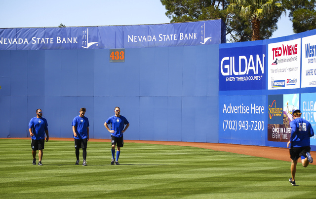Las Vegas 51s players, from left, Chasen Bradford, Paul Seward, Erik Goeddel and Jeff Walters warm up ahead of a game against the El Paso Chihuahuas in Las Vegas on Friday, May 13, 2016. (Chase St ...