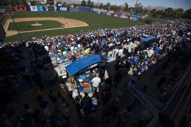 Fans watch the Chicago Cubs play against the New York Mets in their baseball game during Big League Weekend at Cashman Field on Friday, March 1, 2016, in Las Vegas. The Mets won 8-1. Erik Verduzco ...