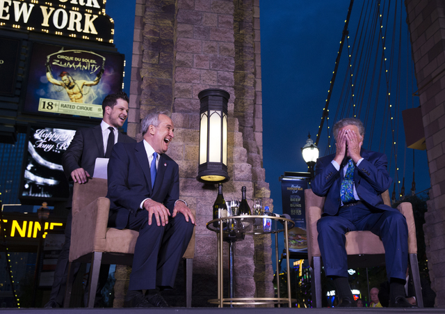 Tony Bennett, right, reacts to hearing Lou Ruvo announce that there will be a street named after the music legend during a champagne toast on Bennett's 90th birthday, Thursday, May 19, 2016, at th ...