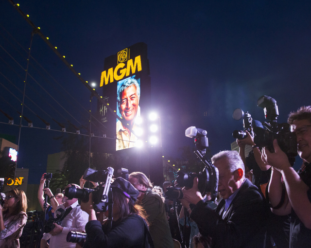 """Photographers point their cameras at Tony Bennett, as images of the music legend were displayed up and down the strip on his 90th birthday, Thursday, May 19, 2016, at the """"Brooklyn Bridge"""" in fron ..."""