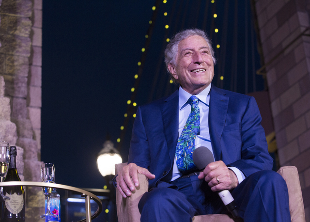 """Tony Bennett looks into the crowd during a champagne toast to the music legend on his 90th birthday, Thursday, May 19, 2016, at the """"Brooklyn Bridge"""" in front of New York-New Yor ..."""