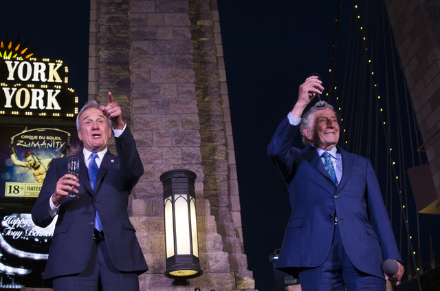 """Tony Bennett, right, and Lou Ruvo toast the crowd on Bennett's 90th birthday, Thursday, May 19, 2016, at the """"Brooklyn Bridge"""" in front of New York-New York Hotel & Casino, i ..."""