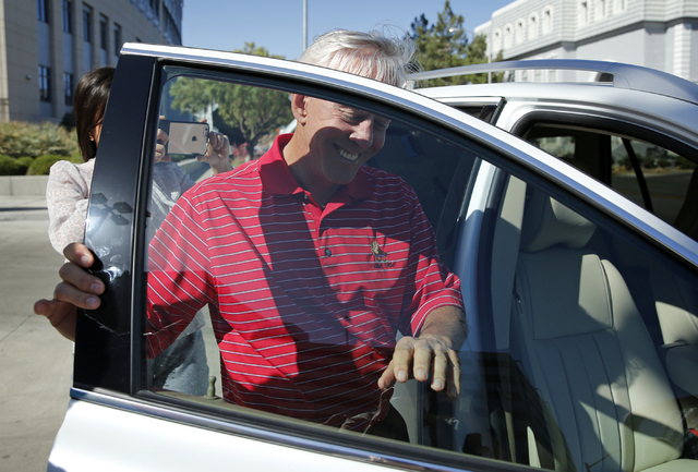 Bill Walters gets into a car after leaving the Lloyd George U.S. Courthouse Thursday, May 19, 2016, in Las Vegas. Walters appeared in federal court on insider trading charges filed in New York.  J ...