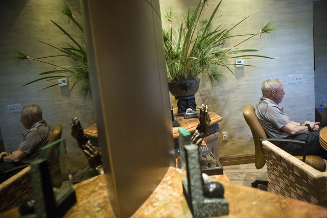 Mike Luce, longtime president of the The Walters Group, is interviewed inside the office of Bill Walters, famed sports bidder and developer, at the Bali Hai Golf Club on Wednesday, May 25, 2016, i ...