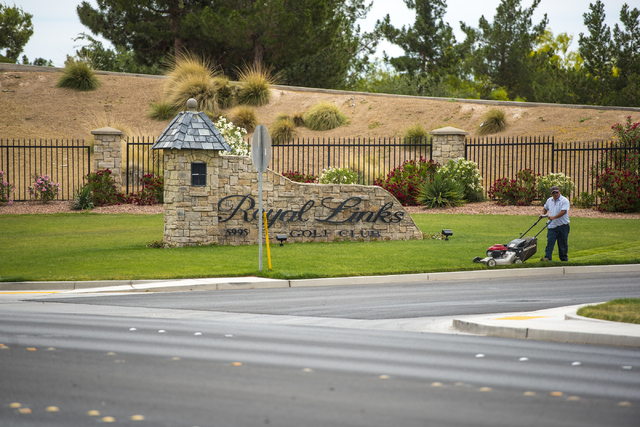 A man cuts the grass out front of Royal Links Golf Club in Las Vegas on Friday, May 20, 2016. Joshua Dahl/Las Vegas Review-Journal