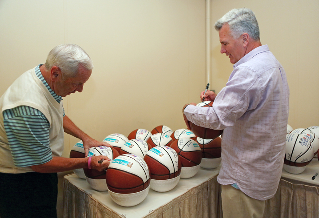 North Carolina coach Roy Williams, left, and Kansas State coach Bruce Weber autograph basketballs at the 9th annual Coaches vs. Cancer Las Vegas Golf Classic hosted at MGM Grand Sunday, May 22, 20 ...