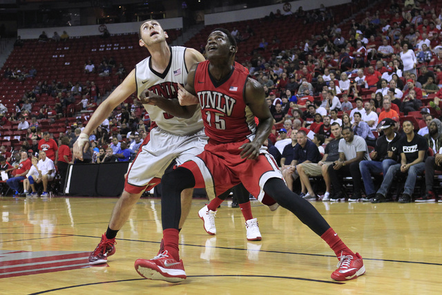 UNLV forwards Ben Carter, left, and Dwayne Morgan jockey for position for a rebound during the annual Scarlet and Gray scrimmage, Thursday, Oct. 16, 2014, at the Thomas & Mack Center. (Sam Mor ...