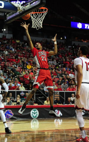 UNLV guard Patrick McCaw (22) goes up for a shot against Fresno State in the second half of their Mountain West Conference semifinal basketball game at the Thomas & Mack Center in Las Vegas Th ...