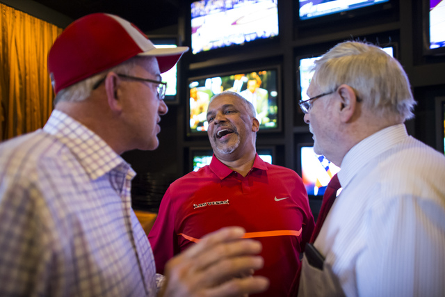 UNLV basketball head coach Marvin Menzies, center, talks with Ed Wilson, left, and Larry Bartsch during a meet and greet at Born and Raised in Las Vegas on Tuesday, May 17, 2016. Chase Stevens/Las ...