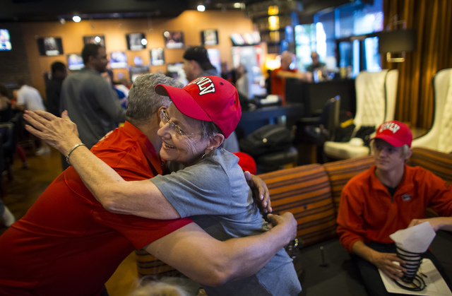 UNLV basketball head coach Marvin Menzies, left, hugs supporter Janet Hopper during a meet and greet at Born and Raised in Las Vegas on Tuesday, May 17, 2016. Chase Stevens/Las Vegas Review-Journa ...