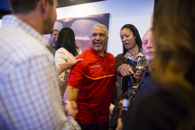 UNLV basketball head coach Marvin Menzies, center, greets attendees during a meet and greet at Born and Raised in Las Vegas on Tuesday, May 17, 2016. Chase Stevens/Las Vegas Review-Journal Follow  ...