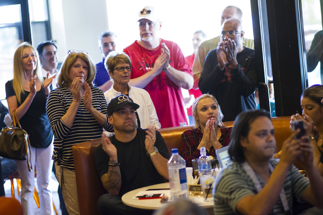 People clap as UNLV basketball head coach Marvin Menzies speaks during a meet and greet at Born and Raised in Las Vegas on Tuesday, May 17, 2016. Chase Stevens/Las Vegas Review-Journal Follow @css ...
