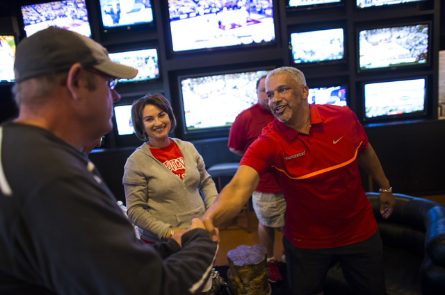 UNLV basketball head coach Marvin Menzies, right, greets attendees during a meet and greet at Born and Raised in Las Vegas on Tuesday, May 17, 2016. Chase Stevens/Las Vegas Review-Journal Follow @ ...