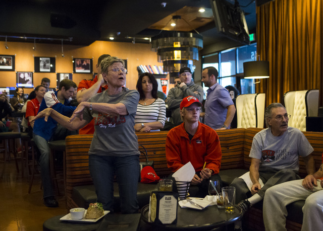 Janet Hopper, left, asks a question during a meet and greet with the UNLV basketball coaching staff at Born and Raised in Las Vegas on Tuesday, May 17, 2016. Chase Stevens/Las Vegas Review-Journal ...