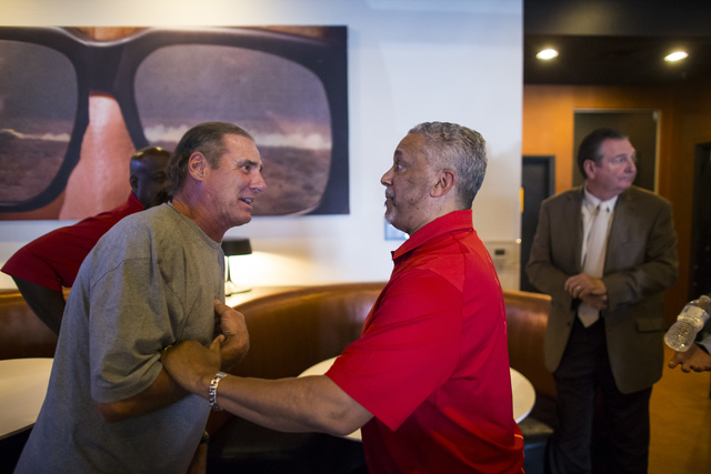 UNLV basketball head coach Marvin Menzies, right, talks with Scott Godino during a meet and greet at Born and Raised in Las Vegas on Tuesday, May 17, 2016. Chase Stevens/Las Vegas Review-Journal F ...
