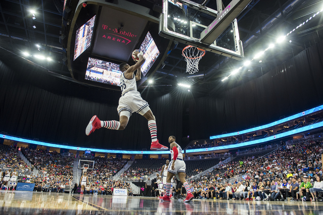 """Titan"" of the Harlem Globetrotters dunks the ball during a performance at T-Mobile Arena in Las Vegas on Tuesday, April 19, 2016. (Martin S. Fuentes/Las Vegas Review-Journal)"