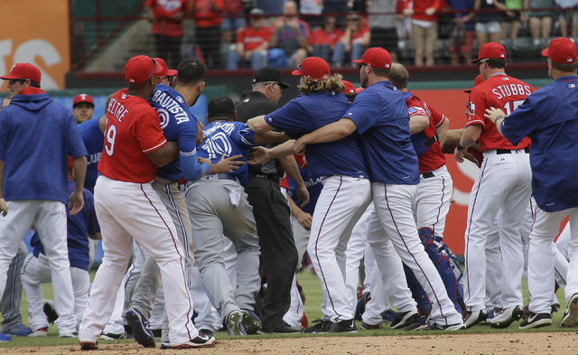 Texas Rangers and Toronto Blue Jays tussle during the eighth inning of a baseball game in Arlington, Texas, Sunday, May 15, 2016. The Rangers won 7-6. The Rangers won 7-6. (LM Otero/AP)