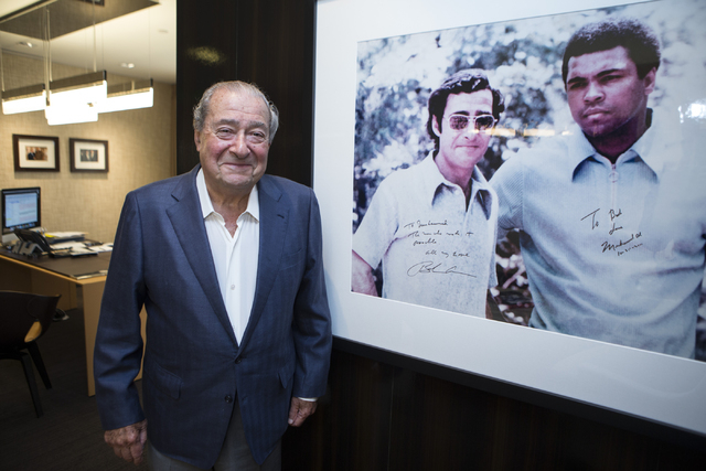Bob Arum, founder and CEO of Top Rank boxing promotions, poses for a portrait next to a photo of him and boxing legend muhammad Ali at the Top Rank headquarters on Wednesday, March 23, 2016, in La ...