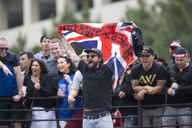 """Fans watch the weigh-in event for Saul """"Canelo"""" Alvarez and Amir Khan at Toshiba Plaza on Friday, May 6, 2016, in Las Vegas. Alvarez and Khan will fight Saturday in the WBC middleweight title bout ..."""