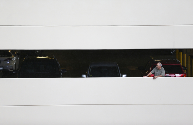A man looks out from the Monte Carlo hotel-casino parking garage before the WBC middleweight championship fight between Canelo Alvarez and Amir Khan at T-Mobile Arena in Las Vegas on Saturday, May ...