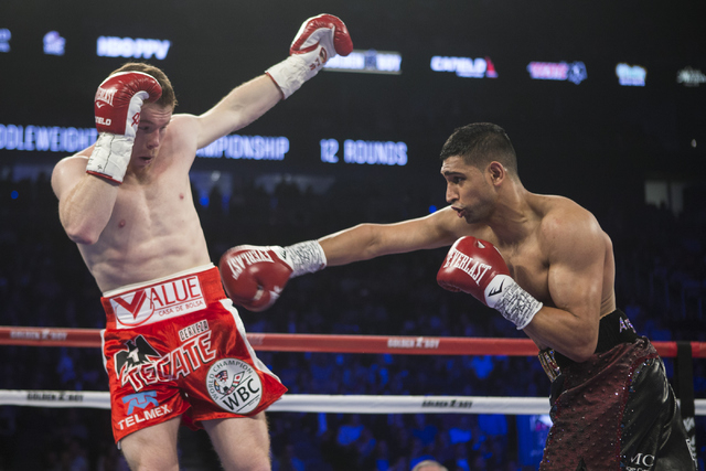 "Saul ""Canelo"" Alvarez, left, moves away from a punch against Amir Khan in the WBC Middleweight Title bout at the T-Mobile Arena on Saturday, May 7, 2016, in Las Vegas. Alvarez won by way of kn ..."