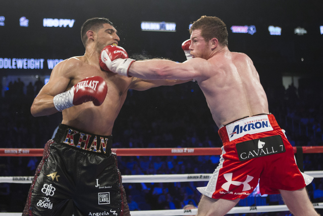 "Saul ""Canelo"" Alvarez, right, connects a left punch against Amir Khan in the WBC Middleweight Title bout at the T-Mobile Arena on Saturday, May 7, 2016, in Las Vegas. Alvarez won by way of kno ..."