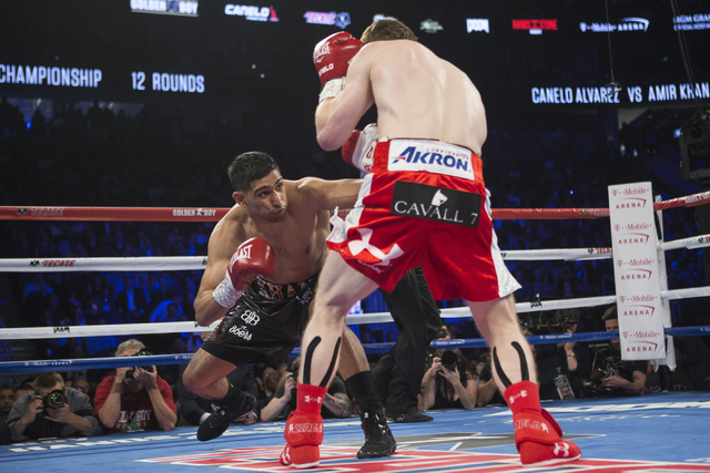 "Amir Khan, left, throws a punch against Saul ""Canelo"" Alvarez in the WBC Middleweight Title bout at the T-Mobile Arena on Saturday, May 7, 2016, in Las Vegas. Alvarez won by way of knockout in ..."