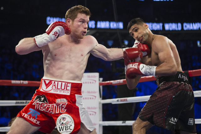 "Saul ""Canelo"" Alvarez, left, connects a left punch against Amir Khan in the WBC Middleweight Title bout at the T-Mobile Arena on Saturday, May 7, 2016, in Las Vegas. Alvarez won by way of knoc ..."