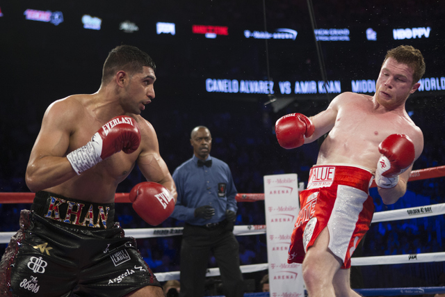 "Amir Khan, left, and Saul ""Canelo"" Alvarez battle in the WBC Middleweight Title bout at the T-Mobile Arena on Saturday, May 7, 2016, in Las Vegas. Alvarez won by way of knockout in the sixth r ..."