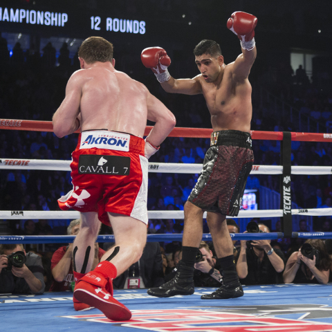 "Amir Khan, right, moves away from a punch against Saul ""Canelo"" Alvarez in the WBC Middleweight Title bout at the T-Mobile Arena on Saturday, May 7, 2016, in Las Vegas. Alvarez won by way of k ..."