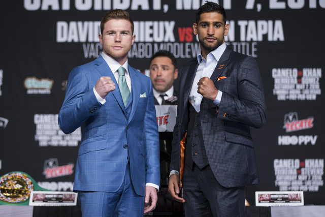 """Saul """"Canelo"""" Alvarez, left, and Amir Khan, pose during their final press conference before their fight at the Ka Theater inside MGM Grand casino-hotel on Wednesday, May 4, 2016, ..."""