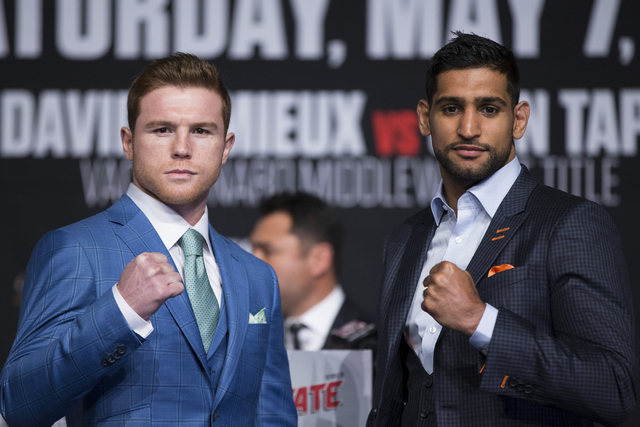 """Saul """"Canelo"""" Alvarez, left, and Amir Khan, poses during their final press conference before their fight at the Ka Theater inside MGM Grand casino-hotel on Wednesday, May 4, 2016 ..."""
