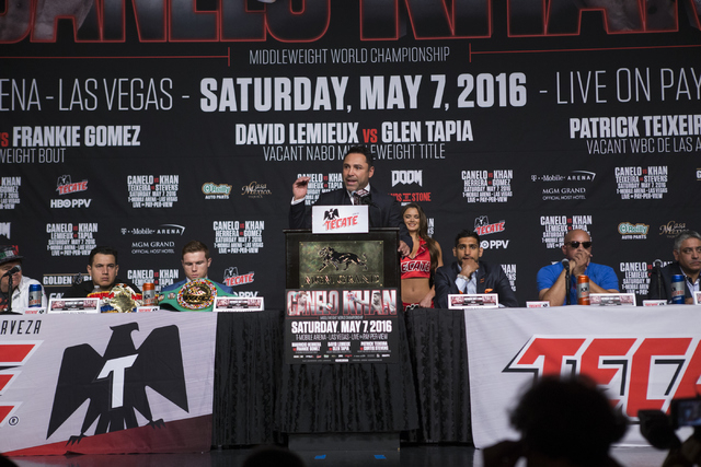 """Boxing promoter and former boxer Oscar De La Hoya speaks during the final press conference for Amir Khan and Saul """"Canelo"""" Alvarez at the Ka Theater inside MGM Grand casino-hotel ..."""