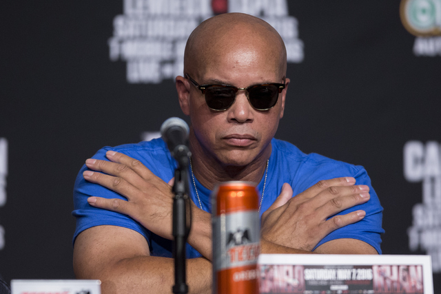 """Boxing trainer Virgil Hunter looks on during the final press conference for Amir Khan and Saul """"Canelo"""" Alvarez at the Ka Theater inside MGM Grand casino-hotel on Wednesday, May  ..."""