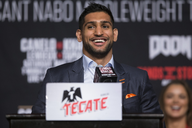 """Amir Khan speaks during his final press conference before his fight against Saul """"Canelo"""" Alvarez at the Ka Theater inside MGM Grand casino-hotel on Wednesday, May 4, 2016, in La ..."""